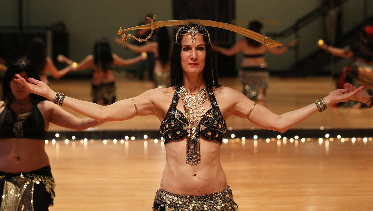 Leith Askins Negley rehearses with the Bohemian Flowers belly-dancing group at Synergy Studio. The group is headed to the Global Belly Dance Conference in Ningbo, China. Above, they rehearse Immortal Egypt-Double Sword and Candle dance by Ansuya Rathor, an internationally renowned artist.
