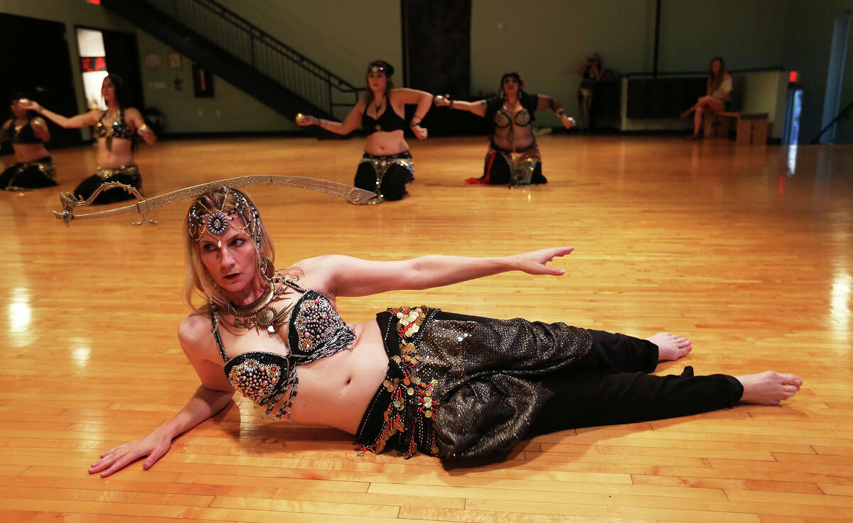 Shannon Askins, 42, rehearses with the rest of the Bohemian Flowers belly dancing group at the Synergy Studio, Wednesday, July 31, 2013. The group is headed to China to compete at the end of August.
