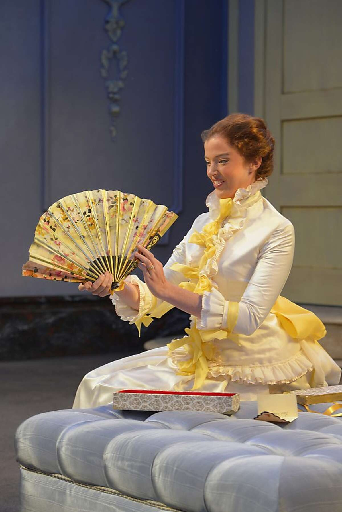 Lady Windermere (Emily Kitchens) admires her favorite birthday present in