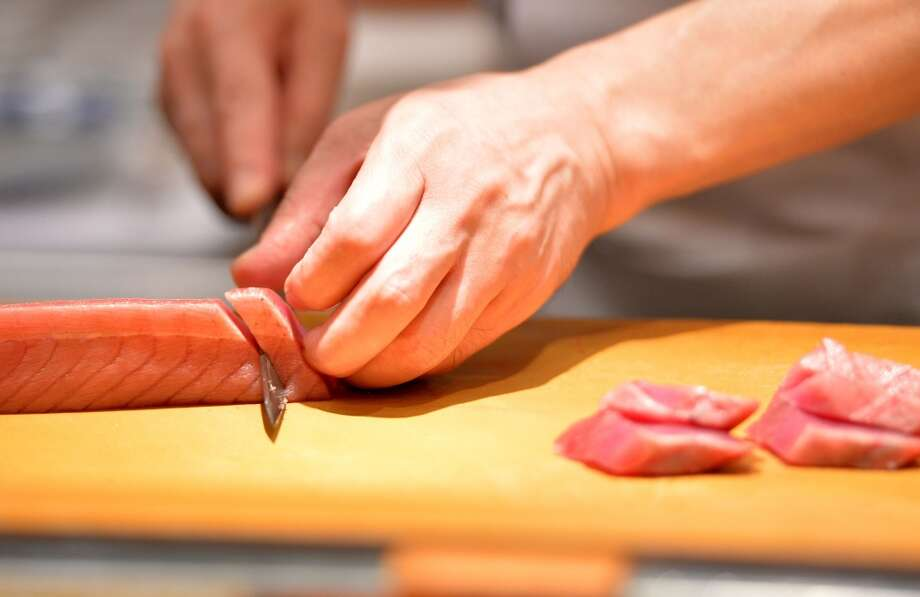 Japan: A chef and restaurant owner slicing up a block of tuna for sushi at a high-end sushi restaurant in Tokyo. Photo: Yoshikazu Tsuno, AFP/Getty Images