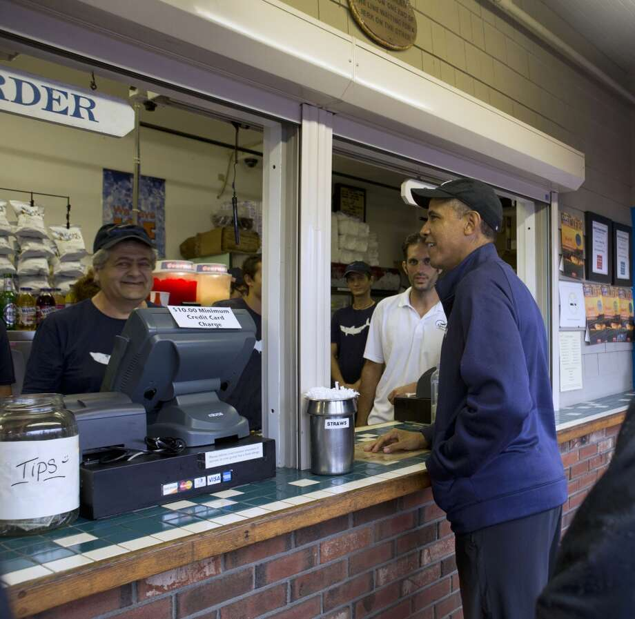 Massachusetts: President Barack Obama orders lunch at Nancy's restaurant in Oak Bluffs, Mass., on the island of Martha's Vineyard. President Barack Obama's fourth summer vacation on the island of Martha's Vineyard is humming along with the usual golf games and basketball. Photo: Jacquelyn Martin, Associated Press