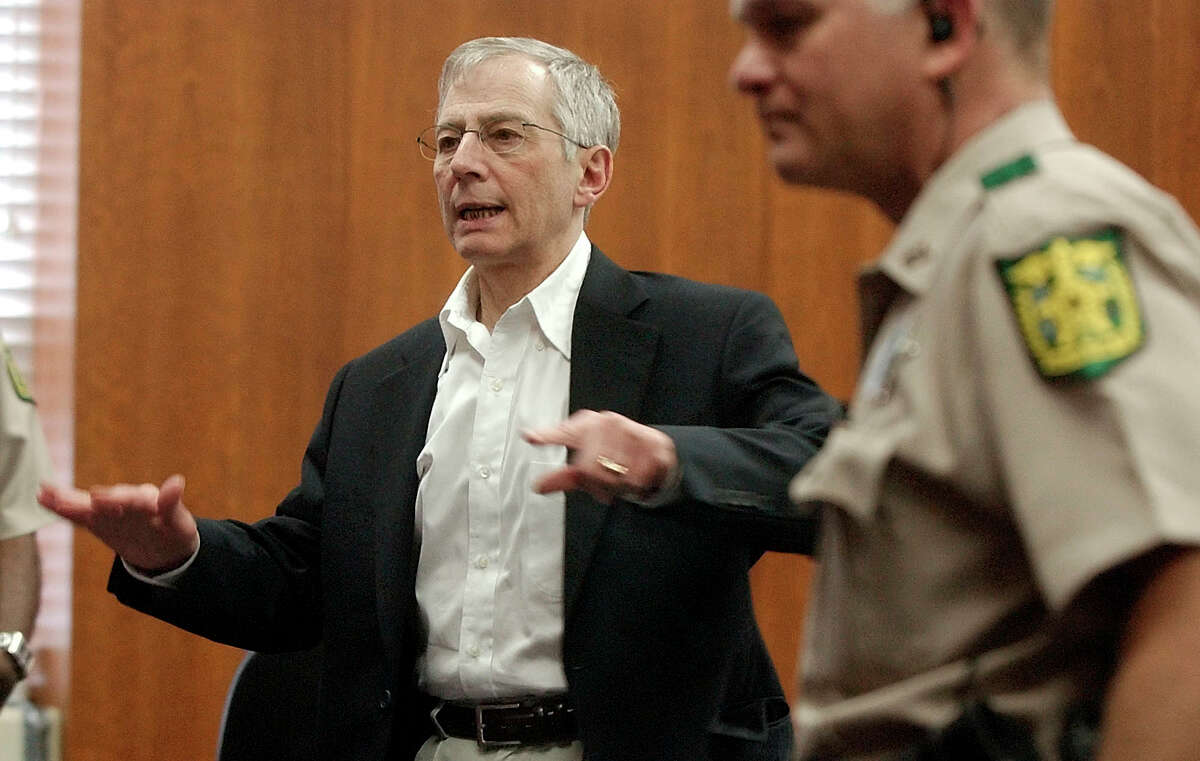 Murder defendant Robert Durst, left, gestures while leaving the courtroom at the end of the days' testimony during his trial in Galveston, Texas, Wednesday, Sept. 24, 2003. (AP Photo/LM Otero) HOUCHRON CAPTION (09/25/2003): It may be three weeks or more before Robert Durst takes the stand.
