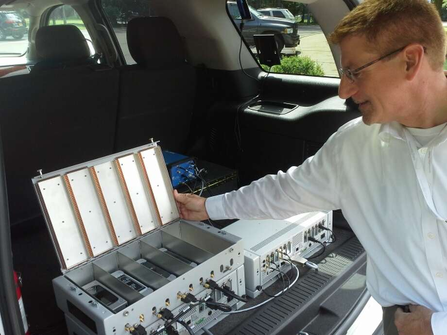 A Verizon Wireless performance engineer shows the system the company uses in its trucks to test its network - and that of its competitors.  Photo by Larry Rulison