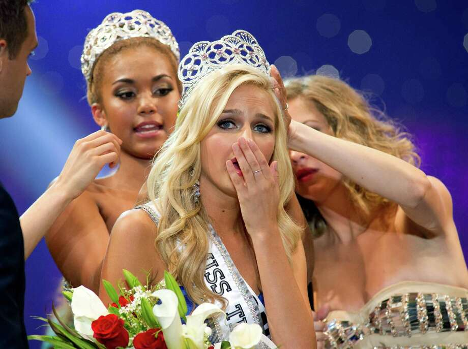 FILE - In this Saturday, Aug. 10,2013 file photo, Miss California Teen USA 2013, Cassidy Wolf, is crowned Miss Teen USA 2013. The FBI is investigating allegations that someone tried to extort nude photographs from the newly crowned Wolf, after hacking into a webcam in her Southern California bedroom. Photo: Miss Universe L.P., LLLP