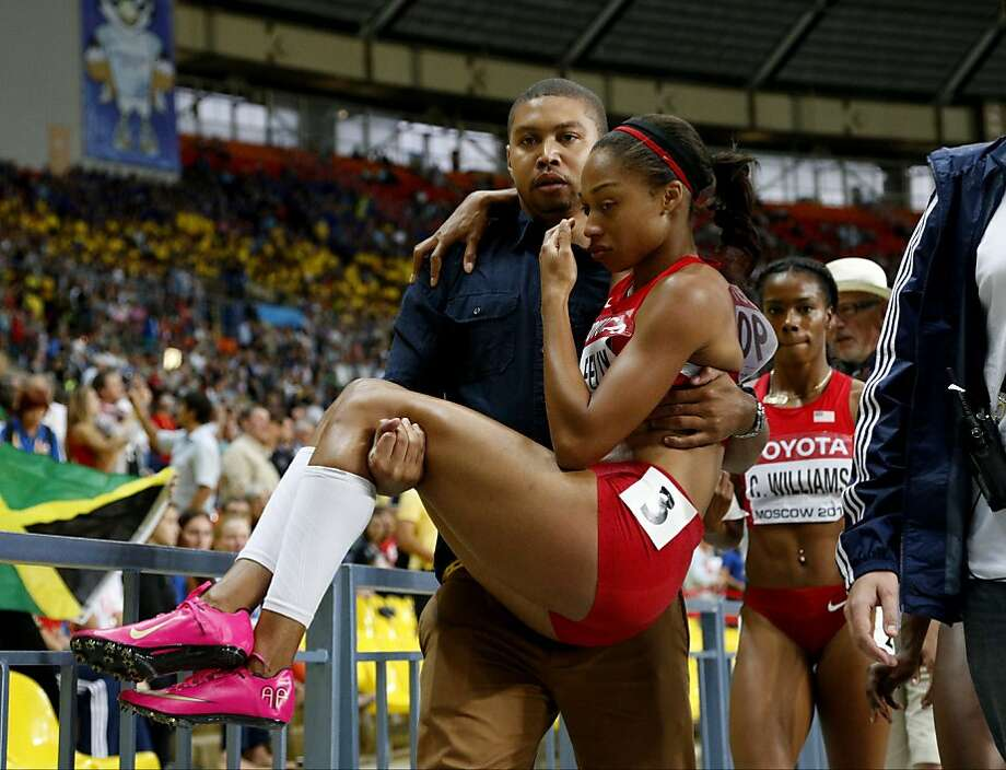 U.S. sprinter Allyson Felix is carried from the track by her brother, Wes Felix. Photo: Alexander Zemlianichenko, Associated Press