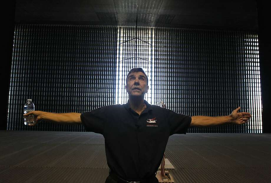 William Warmbrodt, chief of aeromechanics, explains the capabilities of the 80-by-120-foot wind tunnel for guests at NASA's Mountain View research center. Photo: Paul Chinn, The Chronicle