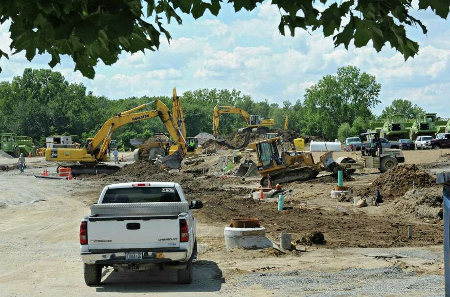 Construction on the site of the future Bellini's Italian eatery and the headquarters of Robert Marini Builders along Route 9 near Hoffman's Playland Friday, Aug. 16, 2013 in Latham, N.Y.  (Lori Van Buren / Times Union) Photo: Lori Van Buren / 00023549A