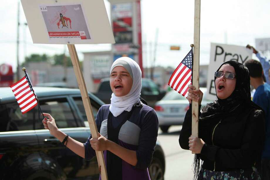 (Left) Rahal Abu-Rezeq, 15, joins the Muslim American Society protest outside the Egyptian Consulate to condemn the violence in Egypt, and call upon international community to restore democratic process and immediately halt assault on peaceful protestors on Friday, Aug. 16, 2013, in Houston. Photo: Mayra Beltran, Houston Chronicle / © 2013 Houston Chronicle