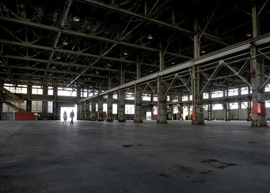 The interior of building 12 at Pier 70 Thursday August 15, 2013 is 250 feet long. Forest City developers are preparing to renovate part of Pier 70 in San Francisco, Calif., including building 12 the former city tow lot, with office space, retail and living spaces. Photo: Brant Ward / The Chronicle / ONLINE_YES