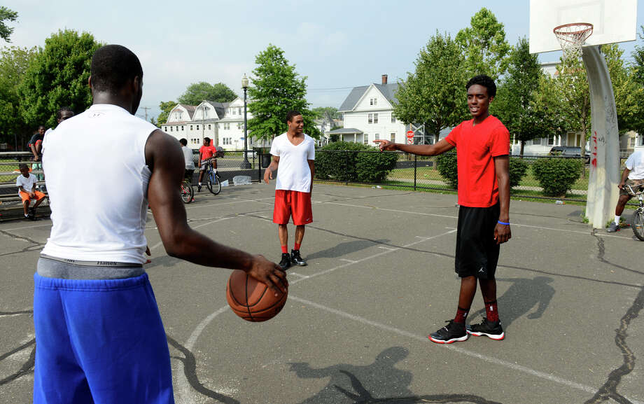 Friends Jerome Parkins, with ball, Corey Baldwin, center, and Jamill Powell, play basketball at Went Park in Bridgeport, Conn. on Wednesday July 10, 2013. Photo: Christian Abraham / Connecticut Post