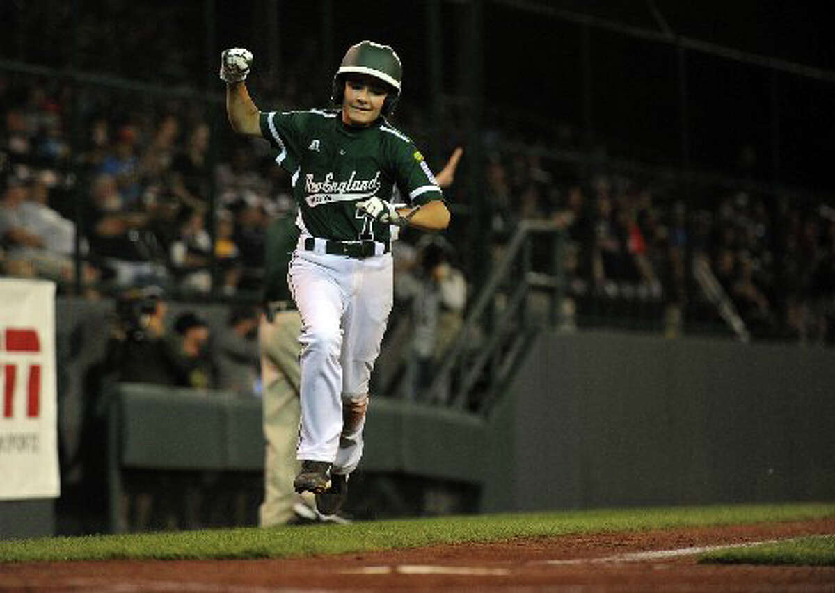 Westport's Chris Drbal, seen racing home with the winning run in Thursday night's World Series opener, and his mates will be back in action Sunday afternoon against the Northwest champions from Washington State.