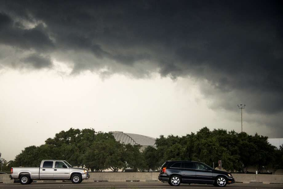 Clouds from an approaching storm are seen over the Reliant Astrodome on Friday. Photo: Smiley N. Pool, Houston Chronicle