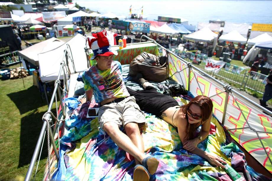 Benjamin Freedland sits atop the Ken Kesey psychedelic bus with Charney during the first day of Seattle's annual Hempfest at Myrtle Edwards Park on Friday, August 16, 2013. The 1940s-era bus was a fixture of the 1960s psychedelic scene and is on display at Hempfest. Photo: JOSHUA TRUJILLO, SEATTLEPI.COM