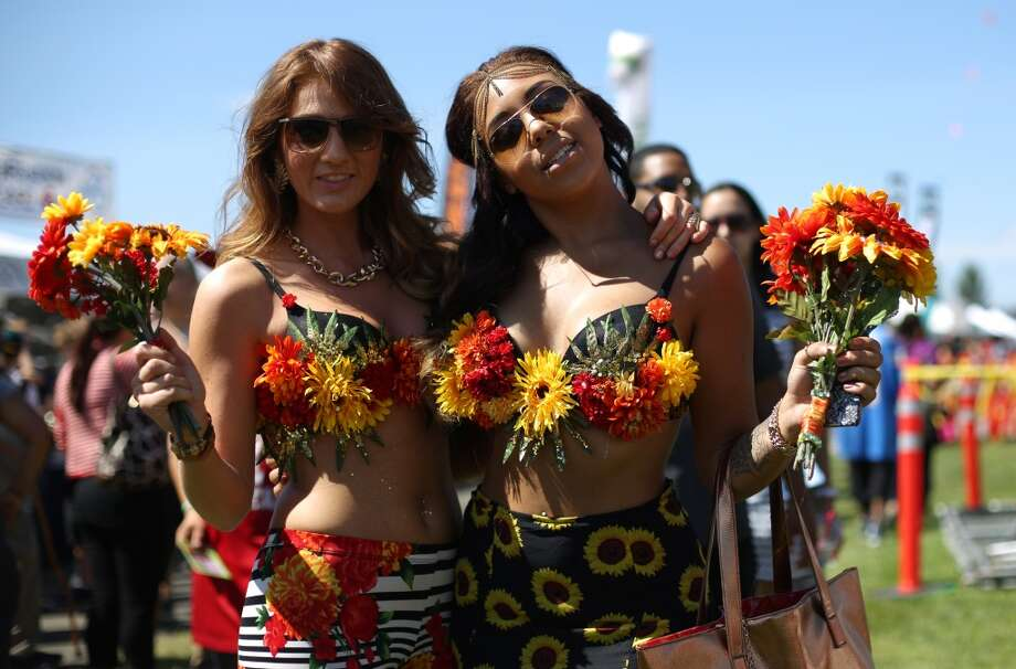Ashley Kelley, left, and Dominique Collins show off their outfits during the first day of Seattle's annual Hempfest at Myrtle Edwards Park on Friday, August 16, 2013. Photo: JOSHUA TRUJILLO, SEATTLEPI.COM