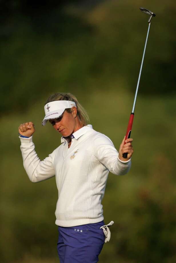 Europe's Suzann Pettersen, of Norway, celebrates a birdie on the second hole during a foursome match in the Solheim Cup golf tournament, Friday, Aug. 16, 2013, in Parker, Colo. (AP Photo/Chris Carlson)  ORG XMIT: COTW114 Photo: Chris Carlson / AP