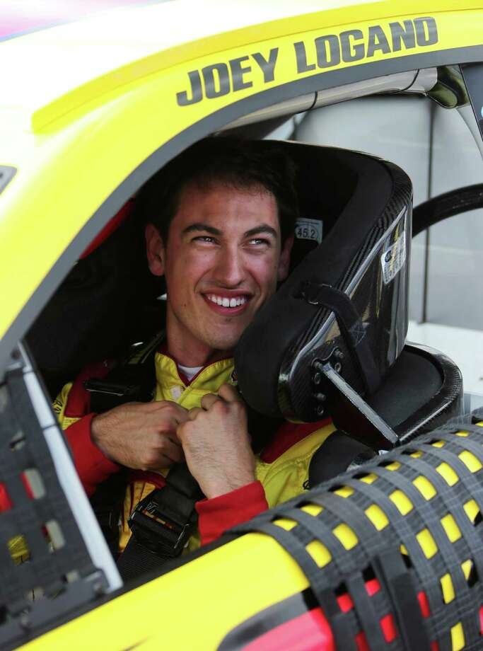 Joey Logano smiles after qualifying for the NASCAR Sprint Cup Series auto race at Michigan International Speedway in Brooklyn, Mich., Friday, Aug. 16, 2013. Logano won the pole. (AP Photo/Bob Brodbeck) ORG XMIT: MIPS113 Photo: Bob Brodbeck / FR3471 AP