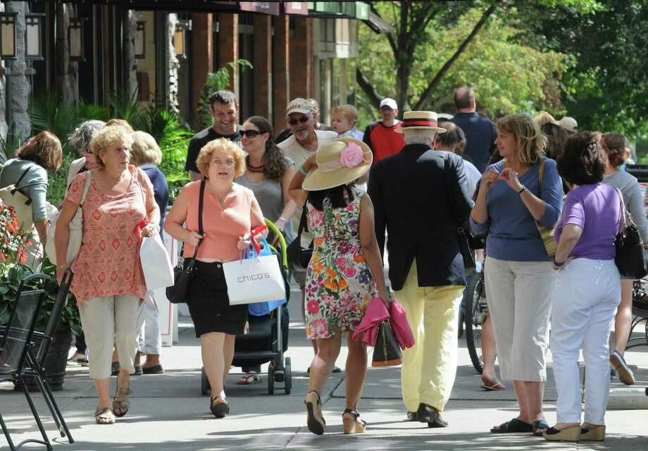 A weekday crowd navigates Broadway on Thursday Aug. 15, 2013 in Saratoga Springs, N.Y.(Michael P. Farrell/Times Union) Photo: Michael P. Farrell / 00023519A
