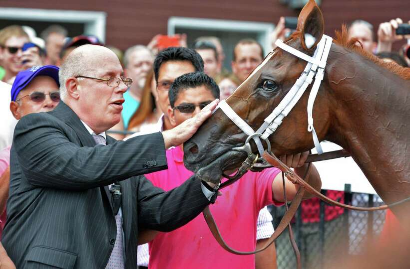 Schenectady native Ed Stanco pets his horse Princess of Sylmar after jockey Javier Castellano rode t