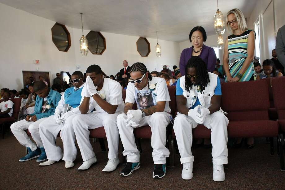 Mayor Jean Quan stands behind the pallbearers of Drew Jackson, 1, who was gunned down along with his father in August. Photo: Lacy Atkins, The Chronicle