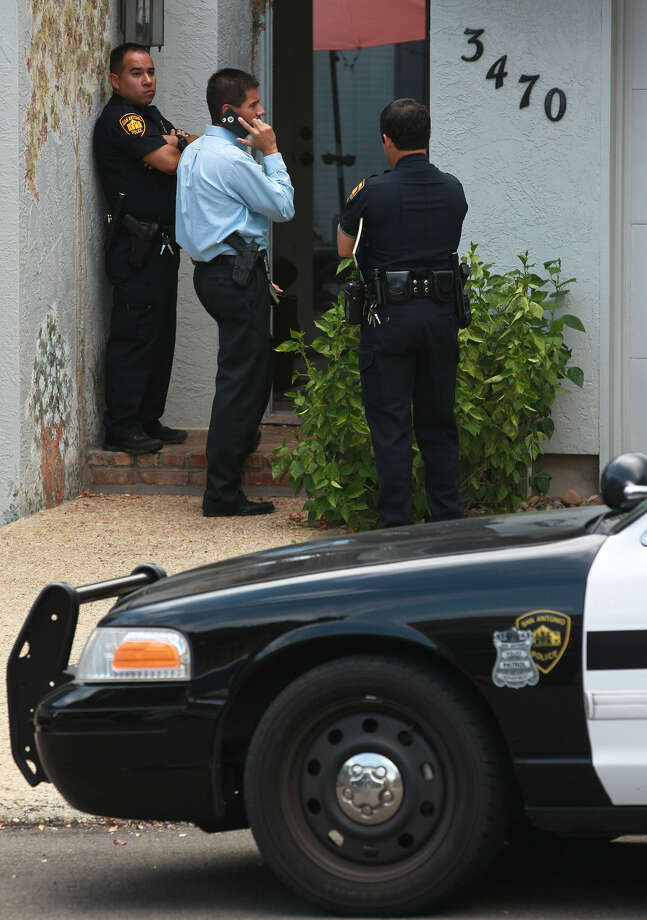 Police investigate the scene of an apparent murder-suicide that took place shortly after noon on the Northwest Side. Police Chief William McManus said a 61-year-old man and a 60-year-old woman were dead at the home. Photo: John Davenport / San Antonio Express-News