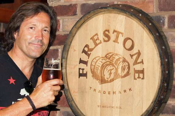 David Walker, middle, co-founder of Firestone Walker Brewing Co. poses for a portrait at the 3rd Floor Bar on Wednesday, Aug. 14, 2013, in Houston. ( J. Patric Schneider / For the Chronicle )