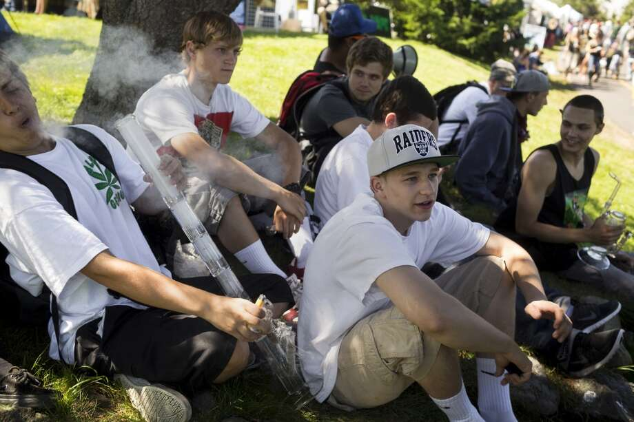 A group of young men share weed and trade off smoking on different bongs on the first day of Seattle Hempfest Friday, August 16, 2013, at Myrtle Edwards Park in Seattle. The annual event, which advocates the idea of decriminalized marijuana, continues through Sunday. Photo: JORDAN STEAD, SEATTLEPI.COM