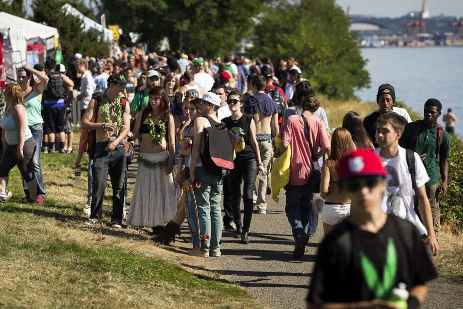Attendees walk about on the waterfront on the first day of Seattle Hempfest Friday, August 16, 2013, at Myrtle Edwards Park in Seattle. The annual event, which advocates the idea of decriminalized marijuana, continues through Sunday. Photo: JORDAN STEAD, SEATTLEPI.COM