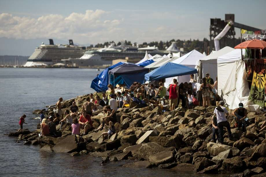 People hang out on the waterfront on the first day of Seattle Hempfest Friday, August 16, 2013, at Myrtle Edwards Park in Seattle. The annual event, which advocates the idea of decriminalized marijuana, continues through Sunday. Photo: JORDAN STEAD, SEATTLEPI.COM