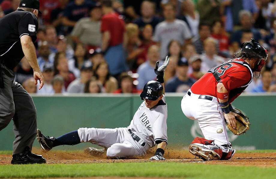 BOSTON, MA - AUGUST 16:  Ichiro Suzuki #31 of the New York Yankees beats the throw to the plate to Jarrod Saltalamacchia #39 of the Boston Red Sox  in the 9th inning to score at Fenway Park on August 16, 2013 in Boston, Massachusetts. (Photo by Jim Rogash/Getty Images) ORG XMIT: 163495039 Photo: Jim Rogash / 2013 Getty Images