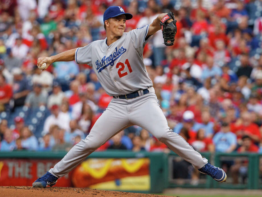 Los Angeles Dodgers starting pitcher Zack Greinke throws to the Philadelphia Phillies during the first inning of a baseball game on Friday, Aug. 16, 2013, in Philadelphia. (AP Photo/Christopher Szagola) ORG XMIT: PACS208 Photo: Christopher Szagola / FR170982 AP