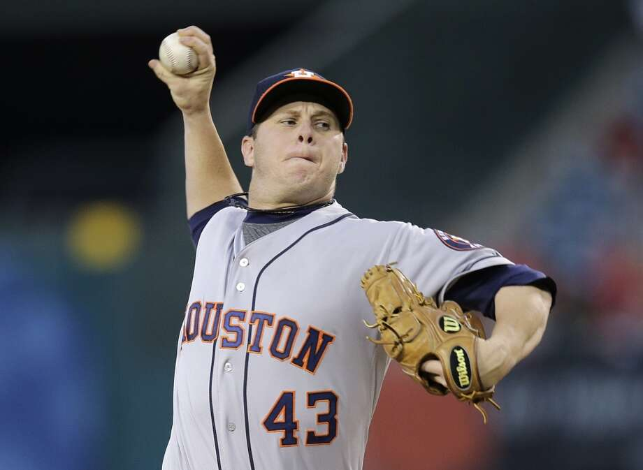 Astros pitcher Brad Peacock makes a throw to the Angels. Photo: Jae C. Hong, Associated Press