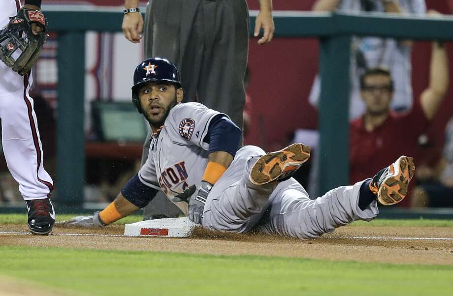 Astros shortstop Jonathan Villar takes third base on a throwing error by Angels pitcher Jerome Williams during the third inning. Photo: Jae C. Hong, Associated Press