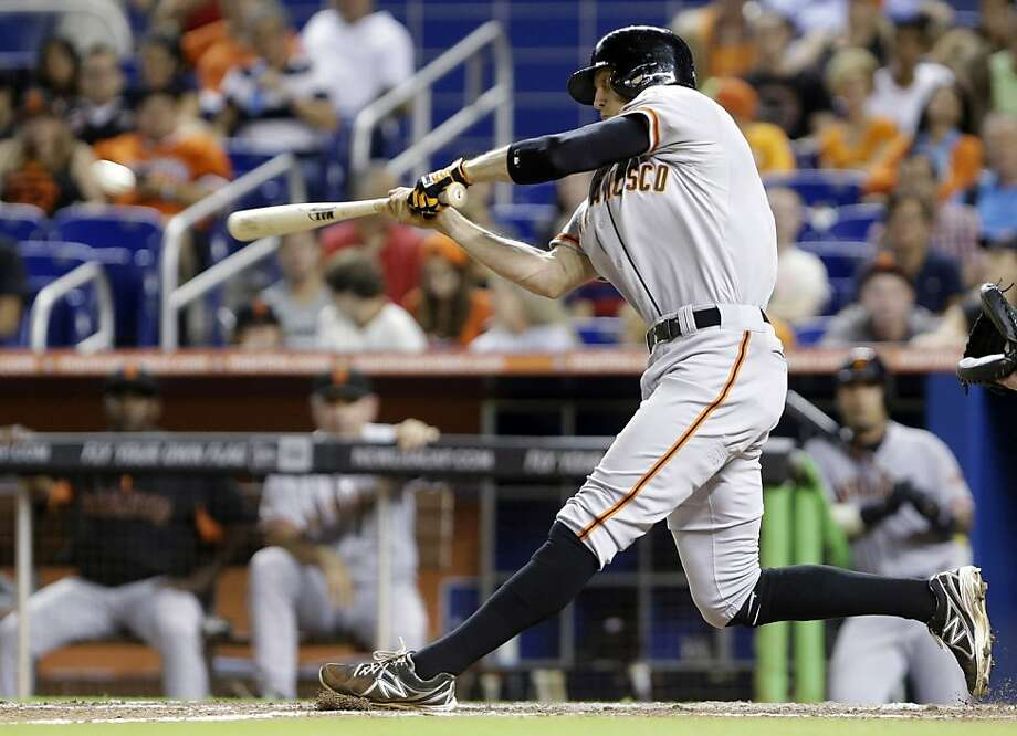 Hunter Pence connects on a triple that gave him the last of his five RBIs. Photo: Wilfredo Lee, Associated Press