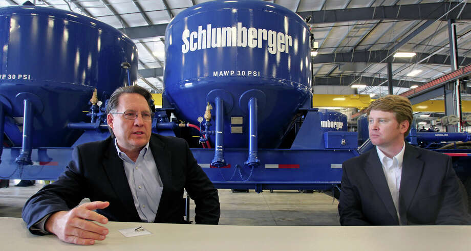 BUSINESS Robert Drummond, President of Schlumberger North America, (left) talks about his company as Jeremy Aumaugher, South Division Operations Manager,listens to questions about expansion of their business to support clients in the Eagle Ford Shale venture. March 7, 2012 Tom Reel/ San Antonio Express-News Photo: TOM REEL, STAFF / TREEL@EXPRESS-NEWS.NET