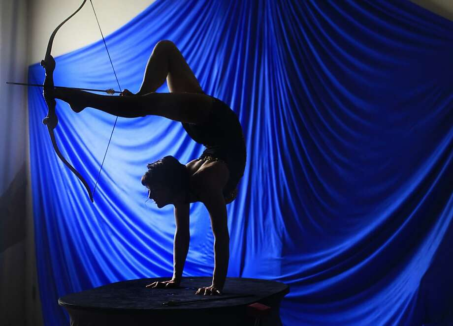 Inka Siefker works on her contortion archery technique at the Royal Russian Kung Fu Circus Training Academy of Heaven Mountain in San Francisco. Photo: Mike Kepka, The Chronicle