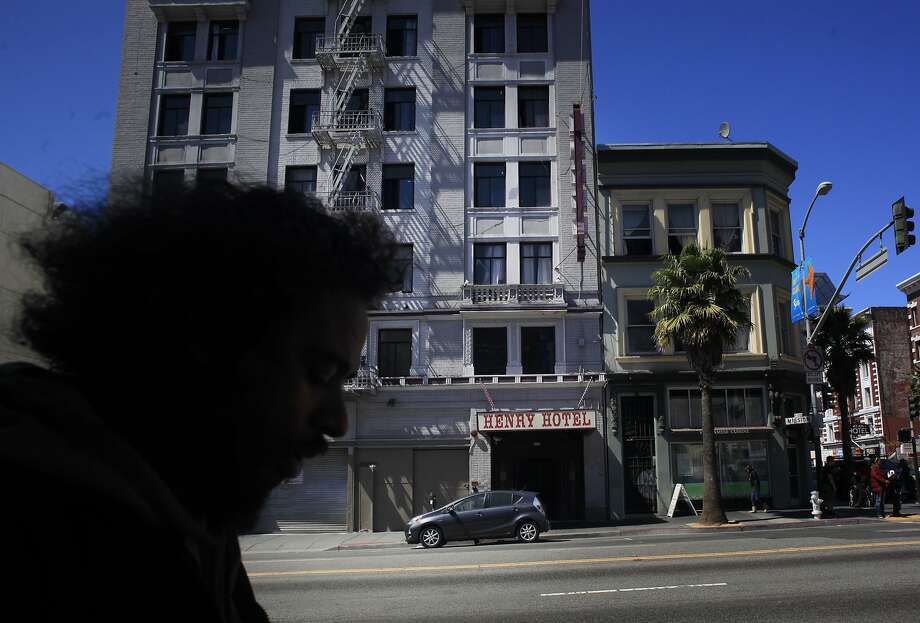 The Henry Hotel, a privately run SRO, towers above the 6th Street corridor in San Francisco's South of Market/Tenderloin district. Photo: Mike Kepka, The Chronicle