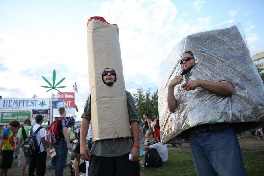 Jhonatan Ruiz and Alexander Lopera wear costumes during the first day of Seattle's annual Hempfest at Myrtle Edwards Park on Friday, August 16, 2013. Photo: JOSHUA TRUJILLO, SEATTLEPI.COM