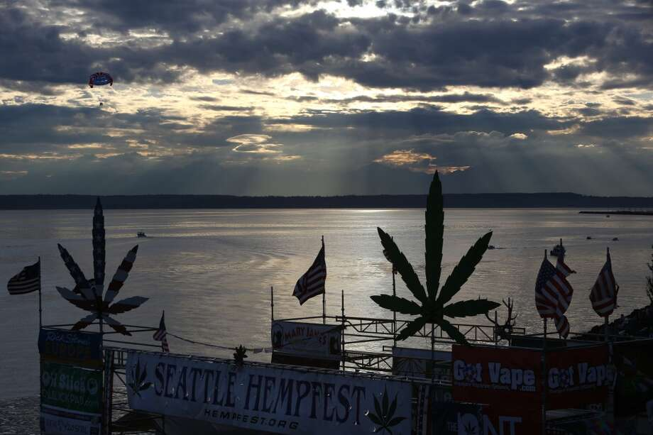 The sun casts rays over Puget Sound during the first day of Seattle's annual Hempfest at Myrtle Edwards Park on Friday, August 16, 2013. Photo: JOSHUA TRUJILLO, SEATTLEPI.COM
