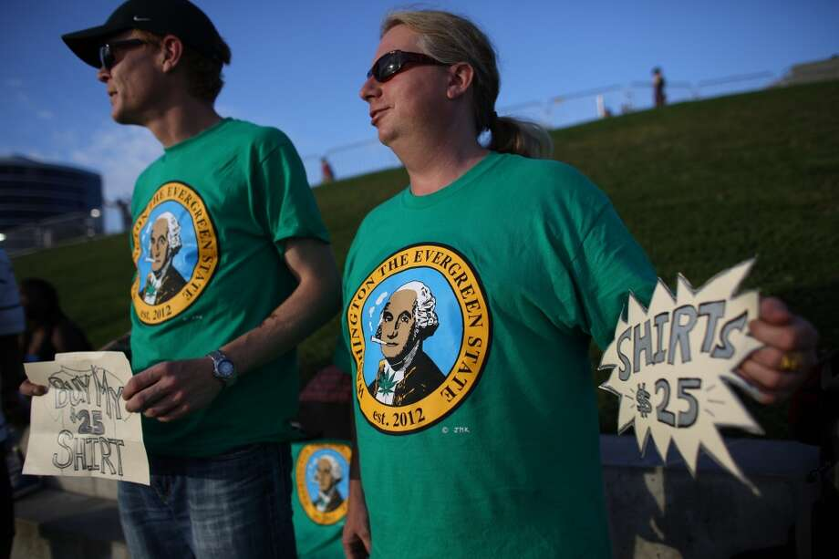 Matt Corelli and Todd Molyneaux sell T-shirts during the first day of Seattle's annual Hempfest at Myrtle Edwards Park on Friday, August 16, 2013. Photo: JOSHUA TRUJILLO, SEATTLEPI.COM