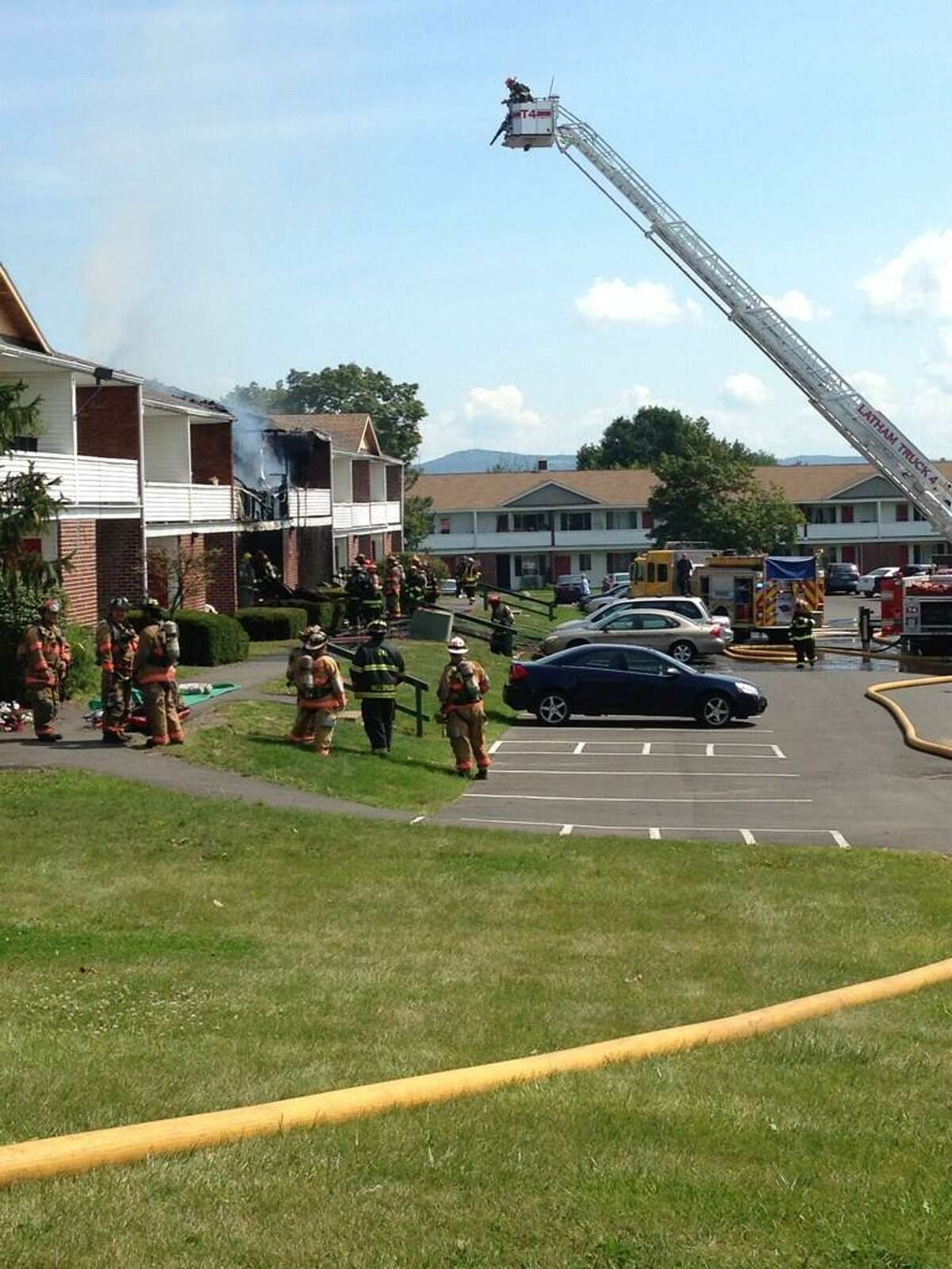 Firefighters get above a structure fire at an apartment complex on Vermont View Drive in Latham on Saturday, Aug. 17, 2013. (Matthew Hamilton/Times Union)
