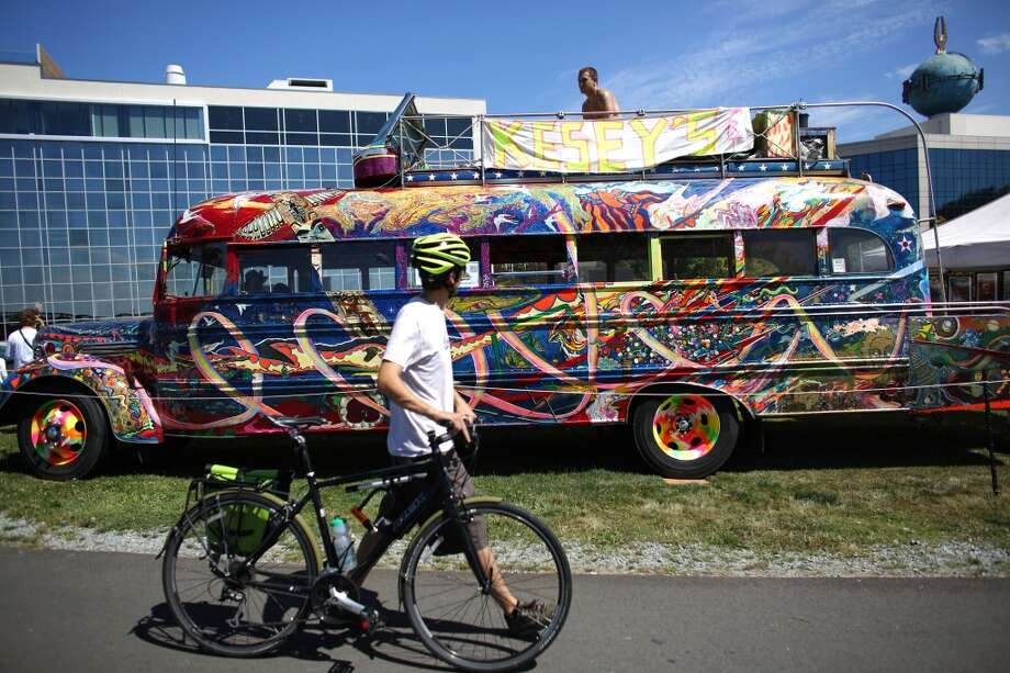 Benjamin Freedland sits atop the Ken Kesey psychedelic bus during the first day of Seattle's annual Hempfest at Myrtle Edwards Park on Friday, August 16, 2013. The 1940s-era bus was a fixture of the 1960s psychedelic scene and is on display at Hempfest. (Joshua Trujillo, seattlepi.com) Photo: JOSHUA TRUJILLO, SEATTLEPI.COM