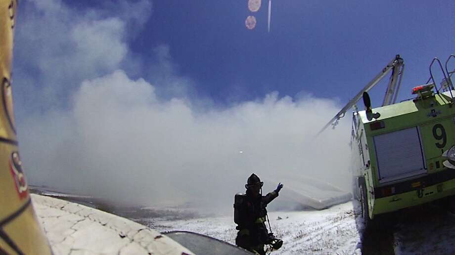 An image from the helmet-mounted video camera of a San Francisco fire battalion chief  at the scene of the crash of Asiana Flight 214 at San Francisco International Airport on July 6, 2013 in San Francisco, California.