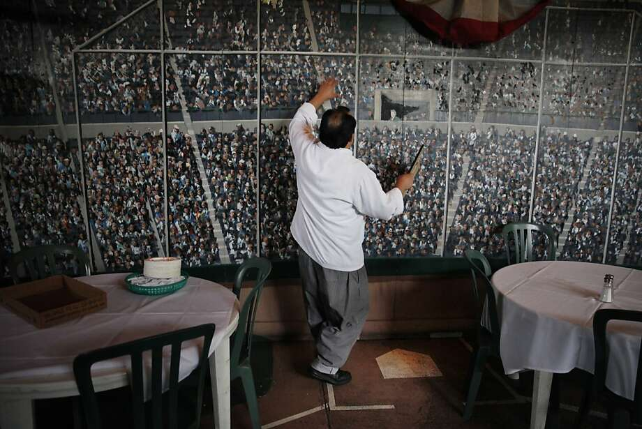 Progress means owner Rafael Hernandez Sr. must lose the Double Play's baseball mural and back room. Photo: Lea Suzuki, The Chronicle