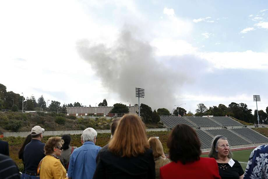 Spectators watch as smoke clears after California State University East Bay building Warren Hall imploded on campus in Hayward, Calif. on August 17, 2013. Photo: Ian C. Bates, The Chronicle