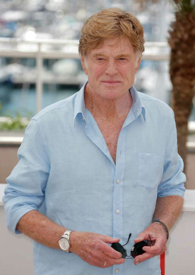 Actor Robert Redford poses for photographers during a photo call for the film All Is Lost at the 66th international film festival, in Cannes, southern France, Wednesday, May 22, 2013. (Photo by Todd Williamson/Invision/AP) Photo: Todd Williamson / Invision