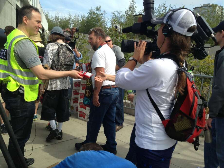 Seattle police department spokesman Sean Whitcomb hands out Doritos at Seattle Hempfest on Saturday. Photo: Jake Ellison/Seattlepi.com