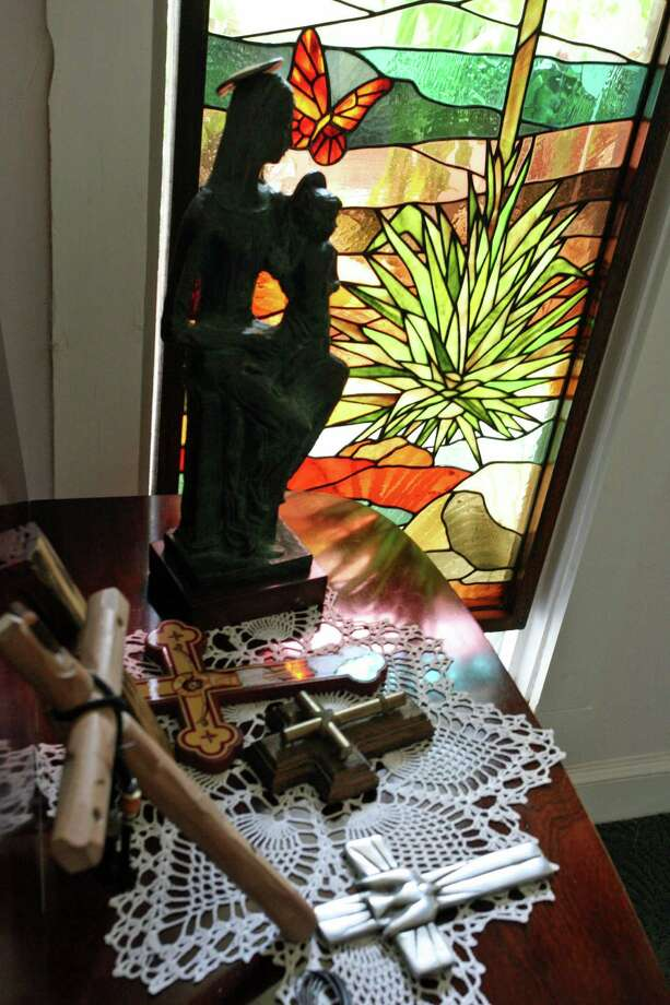 A stained glass panel in a hallway window depicts a yucca plant. Photo: Danny Warner / For The Express-N