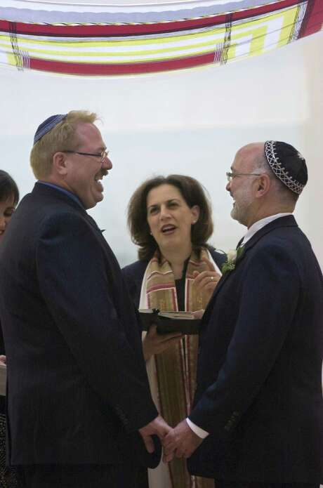 Rabbi Mona Alfi marries Dan Hoody, left, and Dave Felderstein at the Congregation B'Nai Israel in 2008. Photo: Lezlie Sterling, MBR / Sacramento Bee