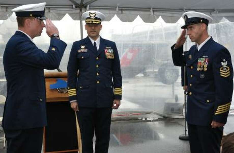 Coast Guard Coast Guard Senior Chief Petty Officer Jason Brisson, right, of Cohoes salutes, after he assumed command of a team that helps private boats safely navigate New York and New Jersey waterways.