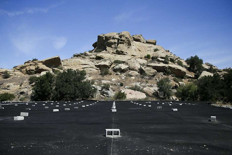 A black tarp covers a field to stabilize mercury-containing soil at the Santa Susana Field Laboratory in Simi Valley in Ventura County. Photo: Jae C. Hong, Associated Press